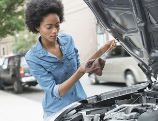 Sharon's sagacious habit of checking her car's oil level every month keeps it running in top form.