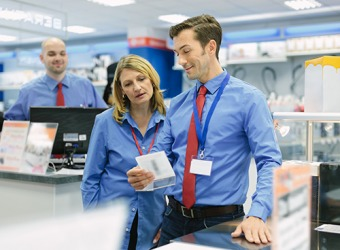 The sales manager makes sure that his employees are aware of the special promotions that the store is currently offering to customers.