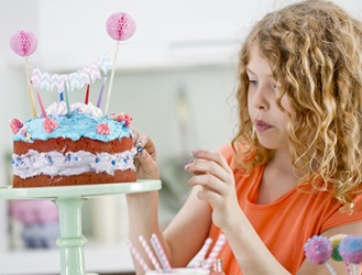 Victoria was finally satisfied with her cake creation after she added the blue candies.