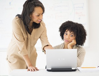 Alicia asked Gail to help her install a new software program on her laptop because her coworker is very computer savvy.
