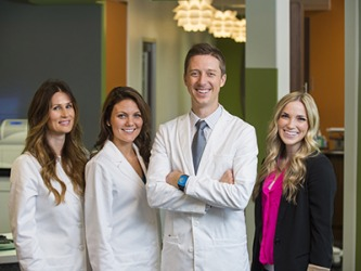 The young dentist obtained an SBA loan to open his new practice and hire staff.