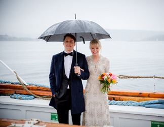 The bride and groom had planned for the scenario in which it rained during their outdoor wedding ceremony.
