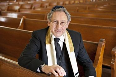A rabbi sitting in a schul (synagogue).