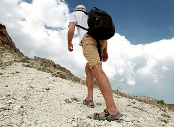 The hiker scrabbled up the trail as he struggled to get his footing on the loose gravel.