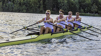 The rowing team goes to the lake five days a week to practice their sculling.