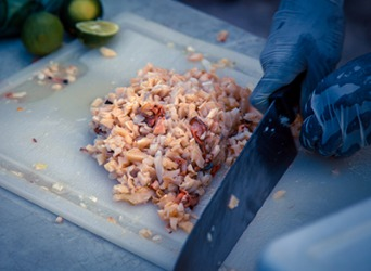 The scungilli (conch meat) is chopped into tiny pieces and added to the fritter batter.