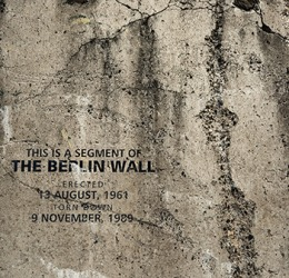 The Berlin Wall was erected by the communist East German government to enforce the segregation of its people from the democratic West.