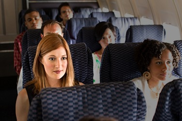 Karen has a fear of flying so she has to muster all of her courage and self control in order to appear calm during the flight.