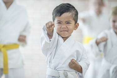 Karate promotes self discipline by teaching students that the next level can not be achieved until certain skills have been mastered first.