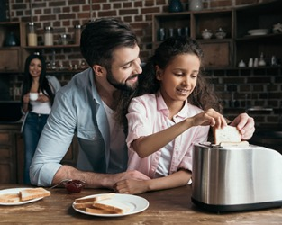 Giana's father knew that using a toaster was fairly self explanatory but he still wanted to give her a few helpful pointers since it was her first time making toast.