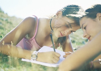 Self-regulation techniques that can help teenagers cope with their emotions in a positive way are journaling and sharing feelings with a close friend.