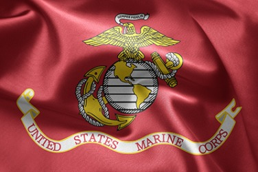 The eagle holds a ribbon with the motto Semper Fidelis on the United States Marine Corps emblem.