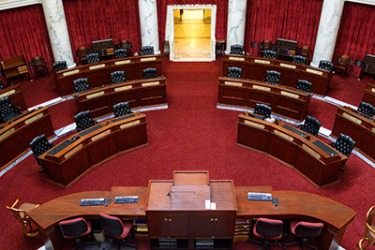 The Idaho senators meet in the senate chamber of the Idaho State Capitol Building in Boise.