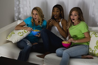 Brittany's friends come over to her house on Thursday nights to watch their favorite TV series together.