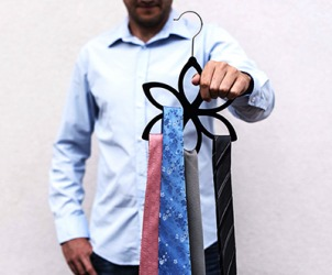 Greg had several ties to choose from that would look good with his blue shirt.