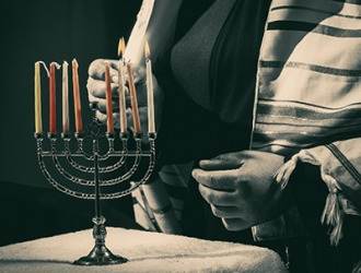One of the duties of the shamas is to light the menorah candles.