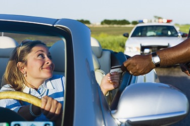 Sabrina looked sheepishly at the officer hoping he would just let her go with a warming instead of giving her a ticket.