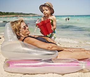 Owen was up to his usual shenanigans by surprising his grammie with a bucket of ocean water as she napped on the beach.