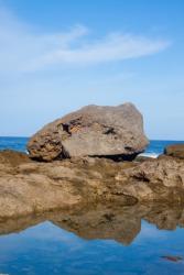 A boulder beside a tide pool.