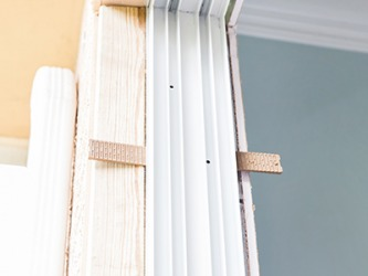 Shimming is necessary to get the frame plumb and level so the door is able to swing correctly.
