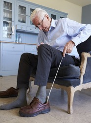 A long handled shoehorn can help the elderly put their shoes on more easily.