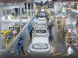 The technicians working on the shop floor have a specific task to do on the automobiles coming down the assembly line.