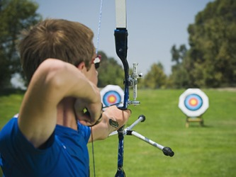 He shot the arrow at the target in his archery class.
