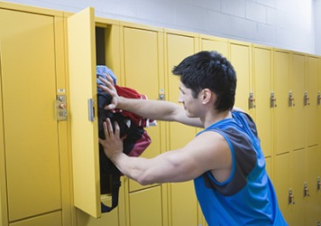 Ross had to shove his clothes into his locker so that he could close the door.