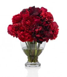 A bouquet of red flowers in a vase.