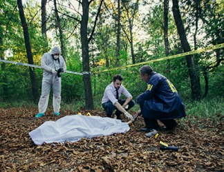 The police shroud the body from view while they gather evidence for the investigation.