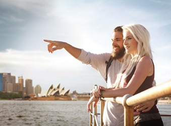 The couple traveling through Australia took a sightseeing cruise in Sydney Harbor.