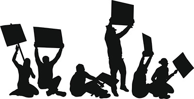 The workers staged a sit in to protest unfair wages.