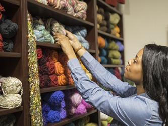 Jeannie selected a skein of yarn for her next knitting project.