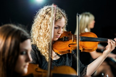 The skillful concert violinist has had formal training and several years of experience.