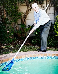 Hugh doesn't mind skimming the leaves in his pool because it helps keep him fit.