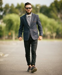 A type of men's hipster outfit is cuffed skinny jeans and a blazer.