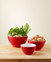 Three bright red bowls.