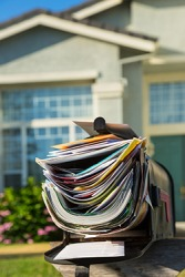 She had a slew of mail in her mailbox when she returned home after being on vacation for a week.