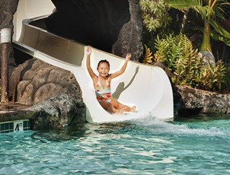 Kimberly enjoyed going down the water slide at the hotel pool.