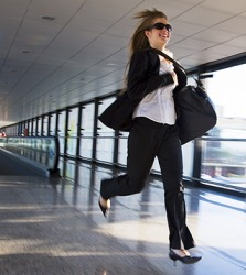Joanie slung her bag over her shoulder as she raced through the airport to catch her flight.