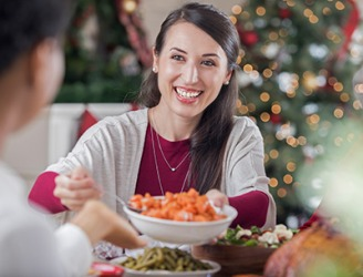 Even though Beverly did not like steamed carrots, she took a small spoonful anyway because her mother in law worked so hard to prepare the holiday meal.