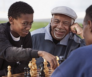 Devon smirked when he made the final move to checkmate his father in the chess game.