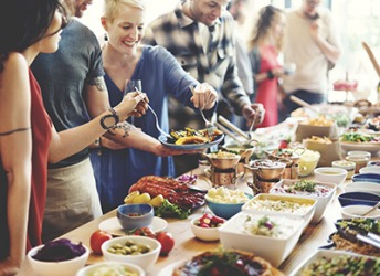 A smorgasbord of delicious dishes was spread out on a long table at the party.