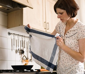 The key to putting out a kitchen grease fire is to smother it with a towel rather than putting it out with water because that makes it worse.