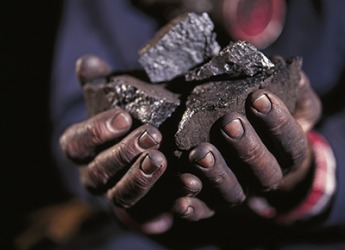 The coal miner has smut all over his hands.