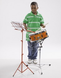 The young boy practices the snare drums.