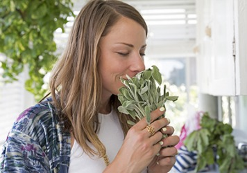 Teri finds it very relaxing to sniff fresh sage and other herbs from her kitchen garden.
