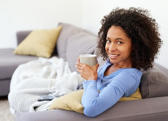 Alexa wrapped up in a snug blanket with a cup of hot tea to watch her favorite TV show.