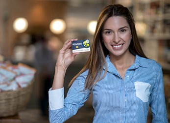 Mia uses her customer loyalty card at her favorite grocery store to get rewards and discounts.