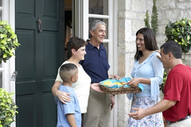 The Carmine's brought cookies to their new neighbors to welcome them to the neighborhood.